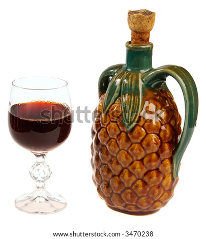 Red wine glass and a exotic antique bottle isolated on white background