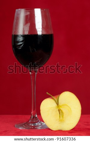 red wine glass and  apple - stock photo