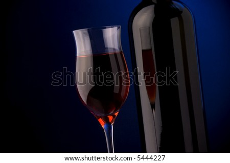 red wine glass and bottle details