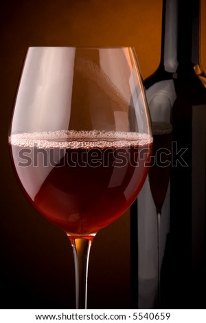 red wine glass and bottle details sparkling