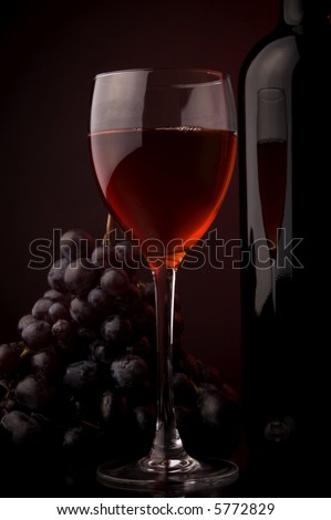 red wine glass and bottle grape