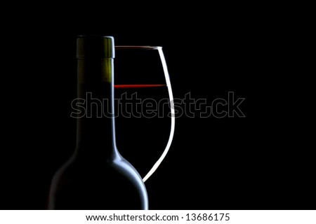 Red Wine Glass and Bottle on Black Background
