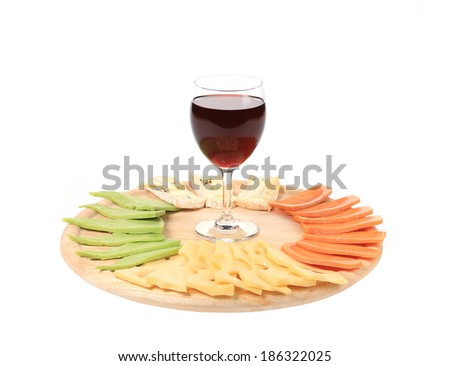 Red wine glass and cheese table. Isolated on a white background.