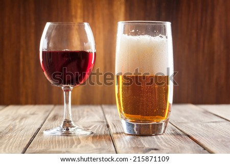 Red wine glass and glass of light beer  - stock photo