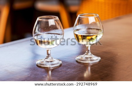 Red wine glass and two bread pieces on a table - stock photo