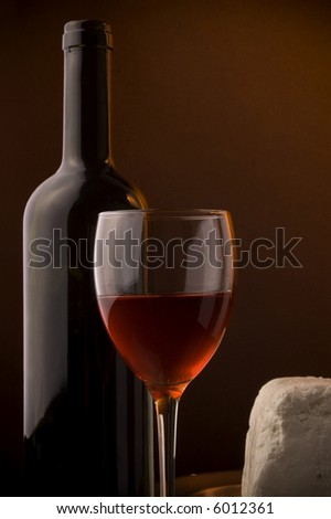 red wine glass bottle and white cheese