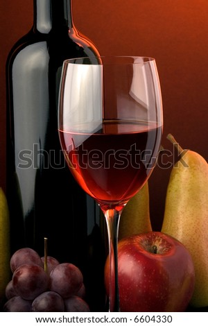 red wine glass bottle apple pear grape - stock photo