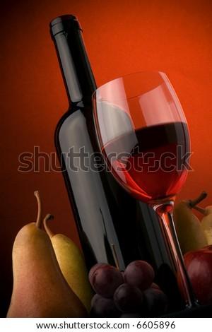 red wine glass bottle details apple pear grape - stock photo
