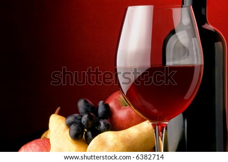 red wine glass bottle details grape pear apple - stock photo