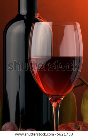 red wine glass bottle details pear apple grape - stock photo