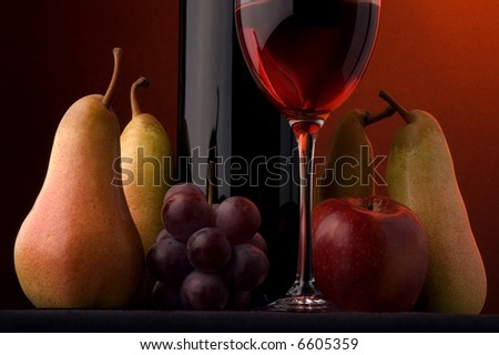 red wine glass bottle fruits pear apple grape - stock photo