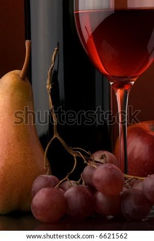 red wine glass bottle grape pear apple - stock photo