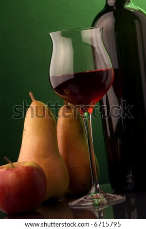 red wine glass bottle pear apple - stock photo