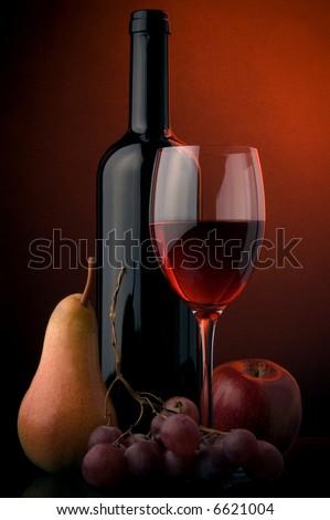 red wine glass bottle pear apple grape - stock photo