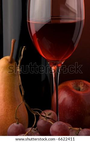 red wine glass bottle pear grape apple - stock photo