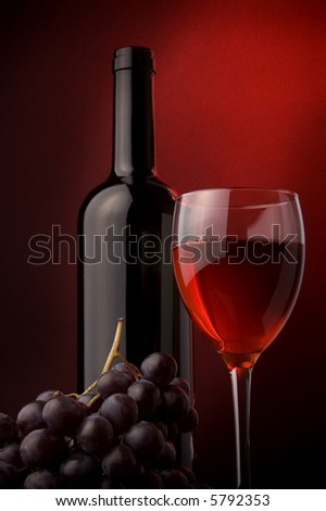 red wine glass grape bottle