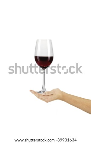 Red wine glass on a hand against a white background - stock photo