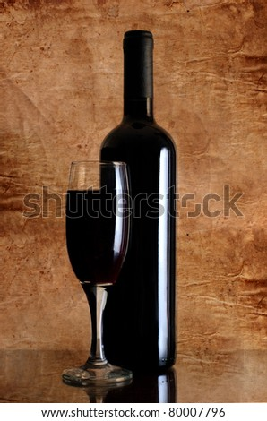 Red wine glass on vintage a background