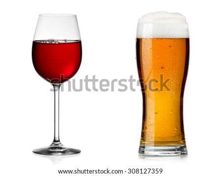 Red wine glass vs beer glass - stock photo