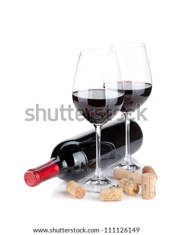 Red wine glasses, bottle and corks. Isolated on white background - stock photo
