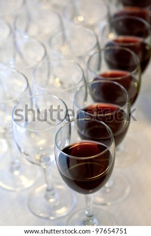 Red wine glasses on a buffet