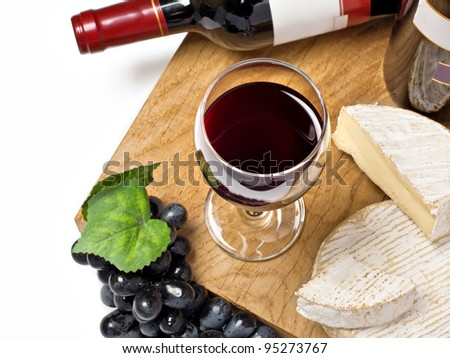 Red wine, grape, Brie and Camembert cheeses  on the wood surface, isolated, white background - stock photo