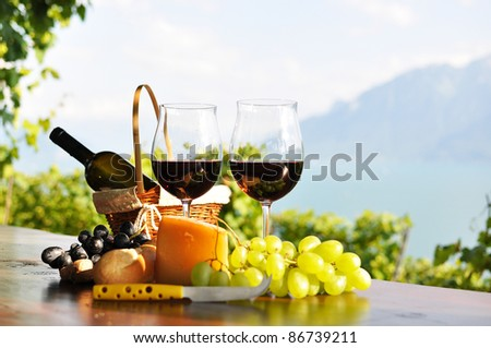 Red wine, grapes and cheese. Lavaux region, Switzerland - stock photo