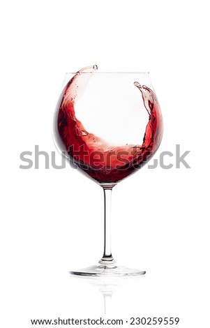 Red wine in a balloon glass. Splash. Wineglasses isolated on white background