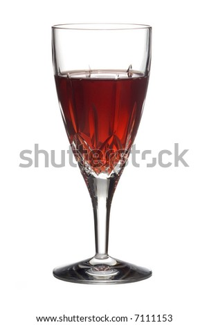 Red wine in a cut crystal flute - stock photo