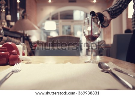 red wine in a French restaurant interior - stock photo