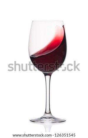 Red wine in a glass  on a white background - stock photo