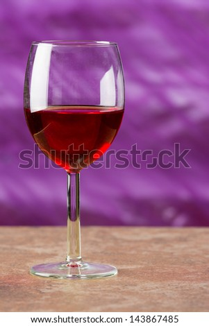 Red wine in a Goblet on a Abstract Color Background