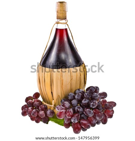 red wine in a pot-bellied bottle with drops of water with a wicker basket and grapes with drops of water isolated on white background - stock photo