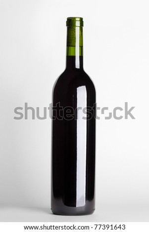 red wine in bottle on white background