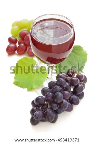 Red wine in glass and red, green and blue grapes branch with leaves isolated on white background - stock photo