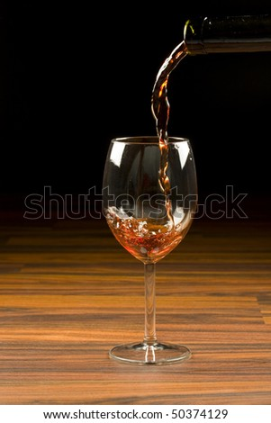 red wine in glass goblet - stock photo
