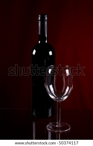 Red wine in glass goblet  on black