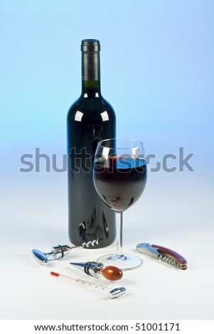 Red wine in glass goblet  on blue