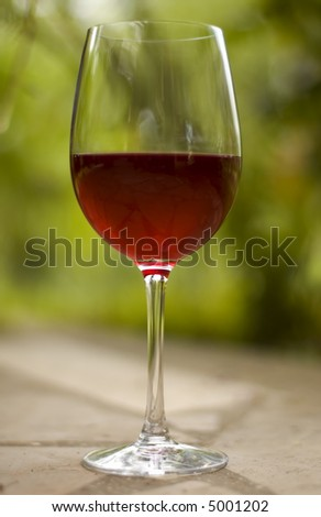 red wine in glass outside close up shoot