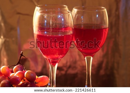 Red wine in glasses and grapes.