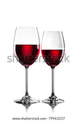 Red wine in glasses isolated on white - stock photo