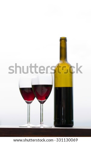 Red wine in glasses with bottle, outdoor