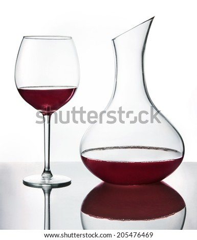 Red wine in the wine glass and decanter - stock photo