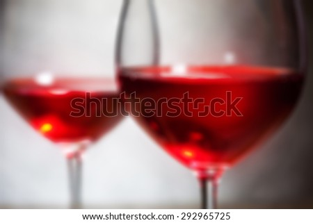 red wine in two goblets. romantic blur still life
