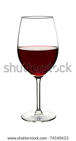 Red wine in wine glass on white - stock photo