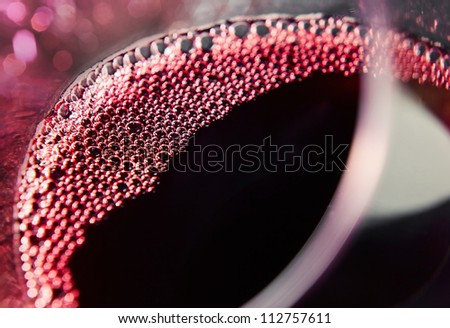 Red wine in wineglass ,focus on a center