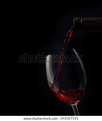 Red wine isolated on black. Luxury old wine. Drink background - stock photo