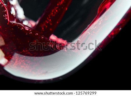 Red wine on a black background, saved clipping path. - stock photo