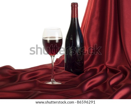 Red wine on red satin - stock photo