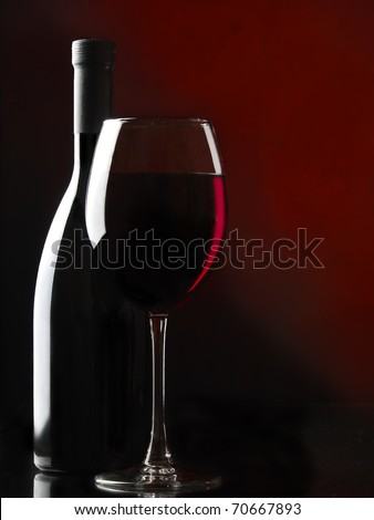 Red wine on the black background - stock photo